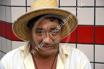 Elderly Brazilian man wearing a straw hat in Manaus, Brazil.