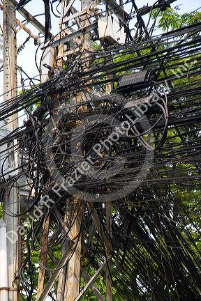 A tangle of telephone wires on a utility pole in Ho Chi Minh City, Vietnam.