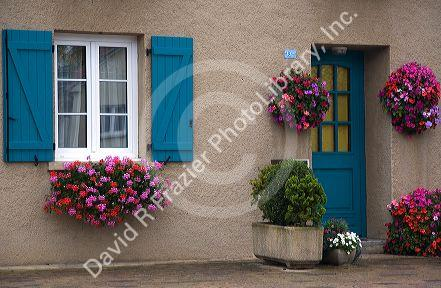 Flower boxes on homes in the commune of Rodemack, northeast France.