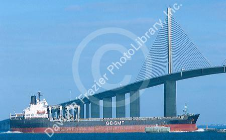 Ship passing under the Sunshine skyway suspension bridge over Tampa Bay, Florida.