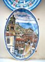 Ceramic  plate on display depicting Amalfi, Italy cathederal.