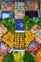 Artistic display of fruit and vegetables at a stand in Gesell, Argentina.