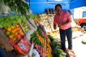 Merchant arranges artistic display of fruit and vegetables at a stand in Gesell, Argentina.