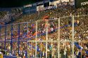 Crowds behind security fences watch a soccer game at the West Stadium in Buenos Aires, Argentina.