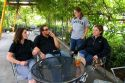 A group of people smoking outdoors at a coffee shop in Boise, Idaho.  MR.