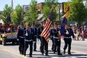 American Legion military veterans honor guard march in a small town Fourth of July parade in Cascade, Idaho.