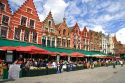Cafes line The Big Market Square at Bruges in the province of West Flanders, Belgium.