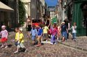 A group of adult supervised French children crossing the street at Bayeux in the region of Basse-Normandie, Normandy, France.