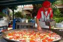 French Basque man cooking paella in the town of Biarritz, Pyrenees-Atlantiques, French Basque Country, Southwest France.