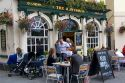 People dine outdoors at The Huntsman pub in Bath, Somerset, England.