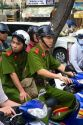 Vietnamese national soldiers ride a motorbike in Ho Chi Minh City, Vietnam.