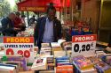 Customer shopping at a bookstore along Boulevard Saint-Michel in the Latin Quarter of Paris, France.